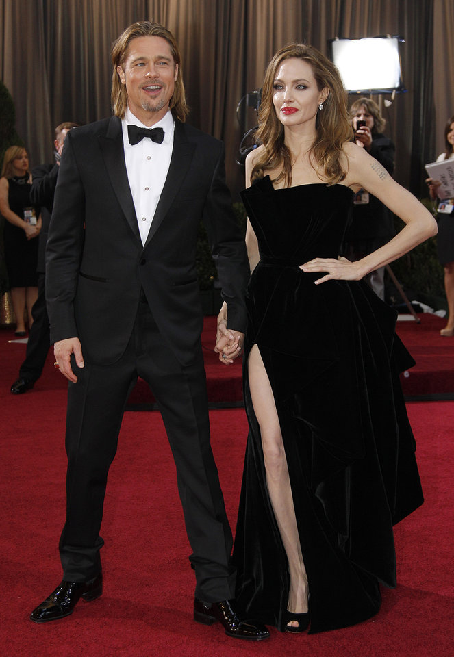Photo -   FILE - In this Feb. 26, 2012 file photo, actress Angelina Jolie, right, and actor Brad Pitt arrive before the 84th Academy Awards in the Hollywood section of Los Angeles. Pitt's manager Cynthia Pett-Dante confirmed their engagement on Friday April 13, 2012. (AP Photo/Amy Sancetta, file)