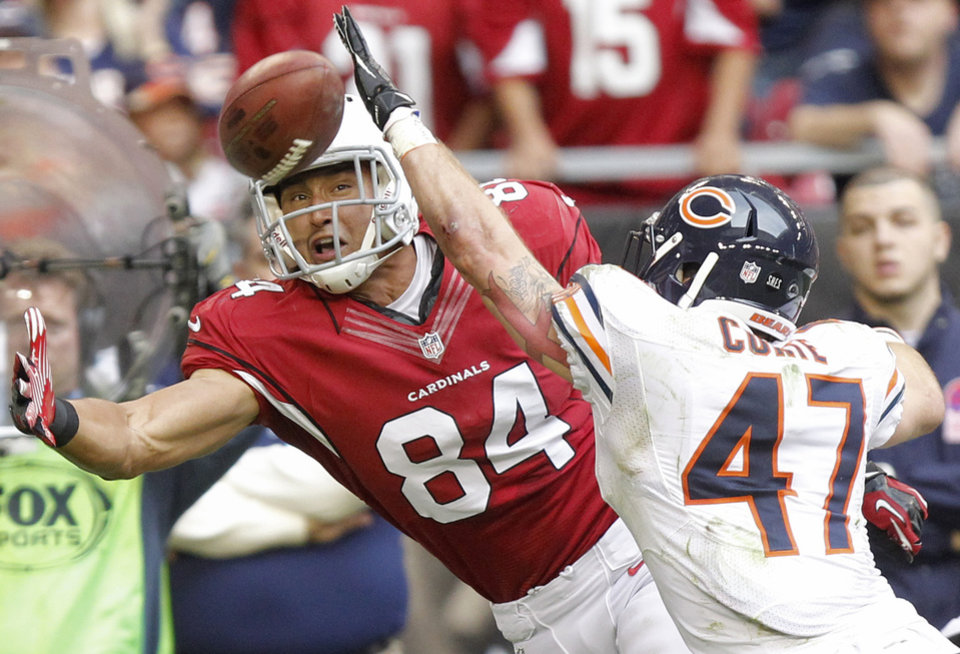 Photo - Arizona Cardinals tight end Rob Housler (84) tries to pull in a pass as Chicago Bears free safety Chris Conte (47) defends during the first half of an NFL football game, Sunday, Dec. 23, 2012, in Glendale, Ariz. (AP Photo/Paul Connors)