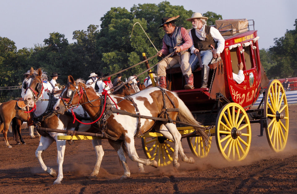 A stagecoach is driven across the arena, trying to escape bandits, during the Pawnee Bill Wild West Show in Pawnee, Oklahoma on Saturday,  June 23, 2012.  Photo by Jim Beckel, The Oklahoman