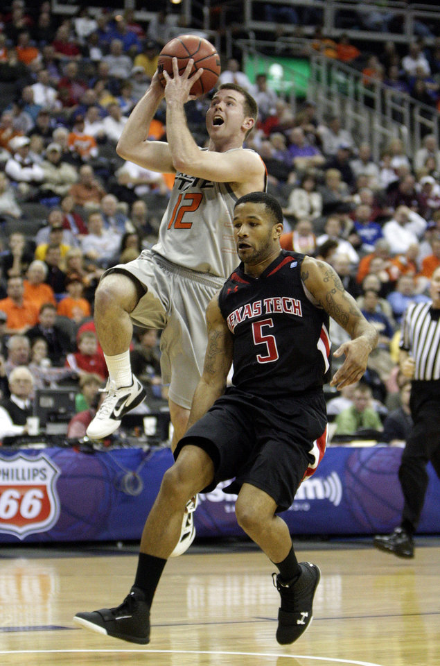 Photo - Oklahoma State's Keiton Page (12) shoots a lay up as Texas Tech's Javarez Willis (5) defends during the Big 12 tournament men's basketball game between the Oklahoma State Cowboys and the Texas Tech Red Raiders at the Sprint Center, Wednesday, March, 6, 2012. Photo by Sarah Phipps, The Oklahoman