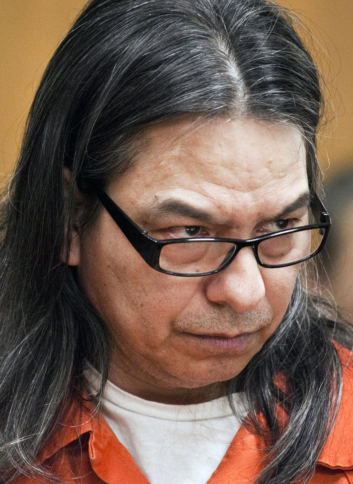 Photo -   Daniel U. Perez, 52, listens during his preliminary hearing in Sedgwick County District Court in Wichita, Kan., Thursday June 7, 2012. Perez, 52, the self-proclaimed leader of a Kansas commune that lived off life insurance payouts of its dead members has been ordered to stand trial on a charge of premeditated first-degree murder. (AP Photo/The Wichita Eagle, Mike Hutmacher)
