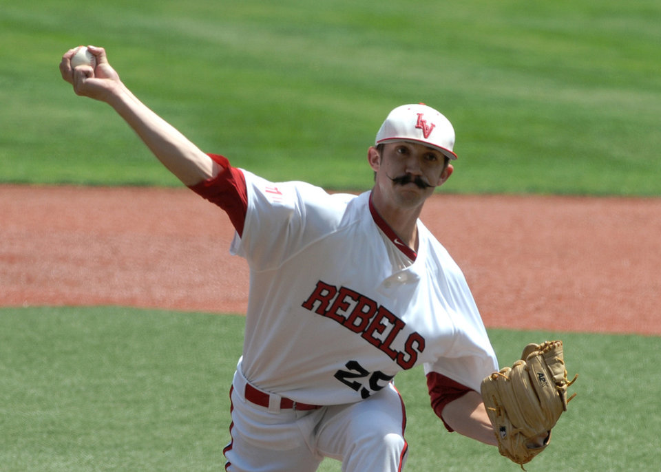 Photo - UNLV's Kenny Oakley delivers a pitch against Oregon State during an NCAA college baseball regional tournament game in Corvallis, Ore., Sunday, June 1, 2014. (AP Photo/Mark Ylen)