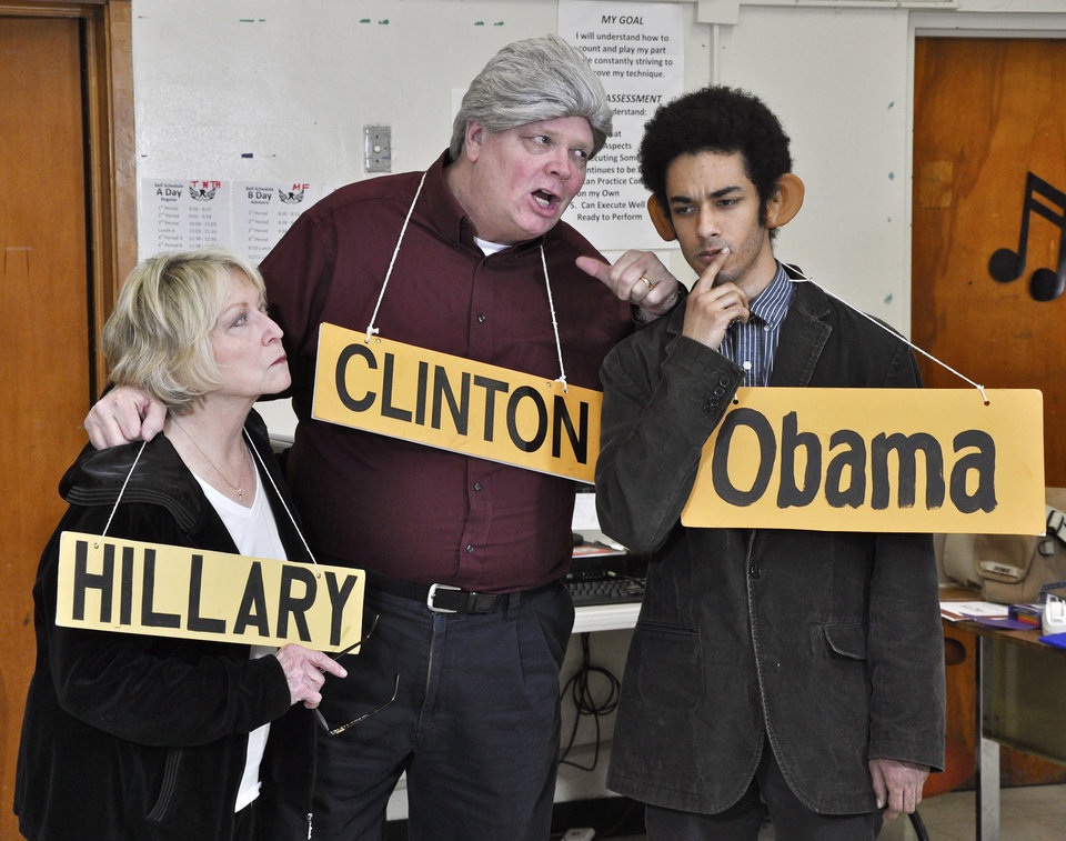 Photo -  From left, Billie Rodely as Hillary Clinton, Bill Perry as President Bill Clinton, and Alex Zabel as President Barack Obama, at a rehearsal for the upcoming 2014 Oklahoma City Gridiron Show.  Photo by M. Tim Blake, for The Oklahoman   M. Tim Blake