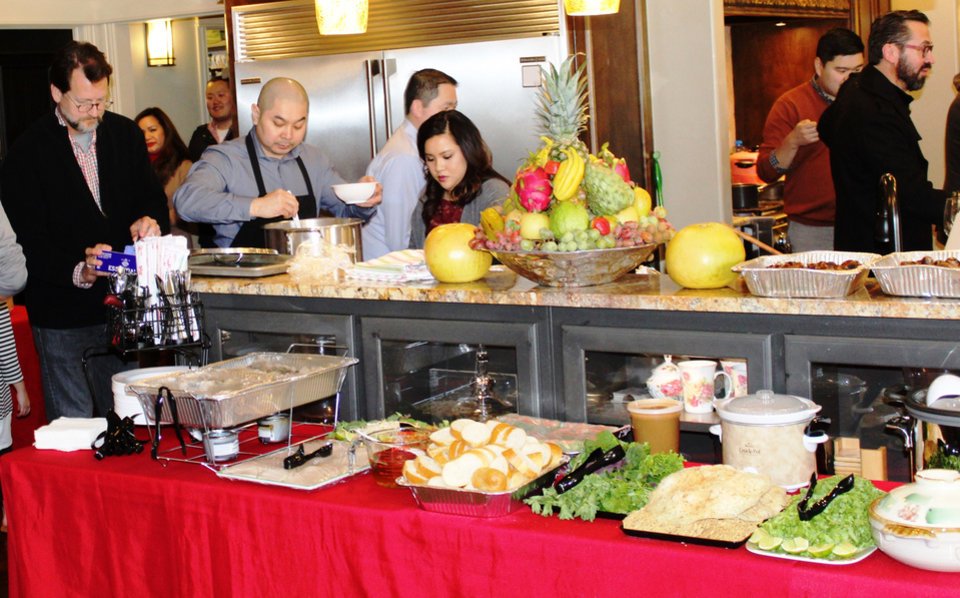 Photo -  The Luong family provided an impressive spread of authentic Vietnamese cuisine for television host and chef Andrew Zimmern and the crew for his show