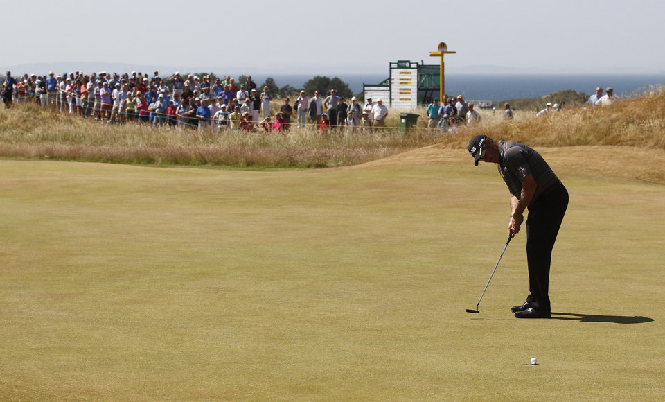 Photo - Lee Westwood of England putts on the 16th green during the second round of the British Open Golf Championship at Muirfield, Scotland, Friday July 19, 2013. (AP Photo/Jon Super)