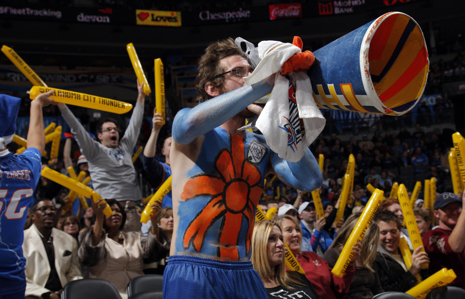 Fans cheer during the opening day NBA basketball game between the Oklahoma CIty Thunder and the Orlando Magic at Chesapeake Energy Arena in Oklahoma City, Sunday, Dec. 25, 2011. Photo by Sarah Phipps, The Oklahoman