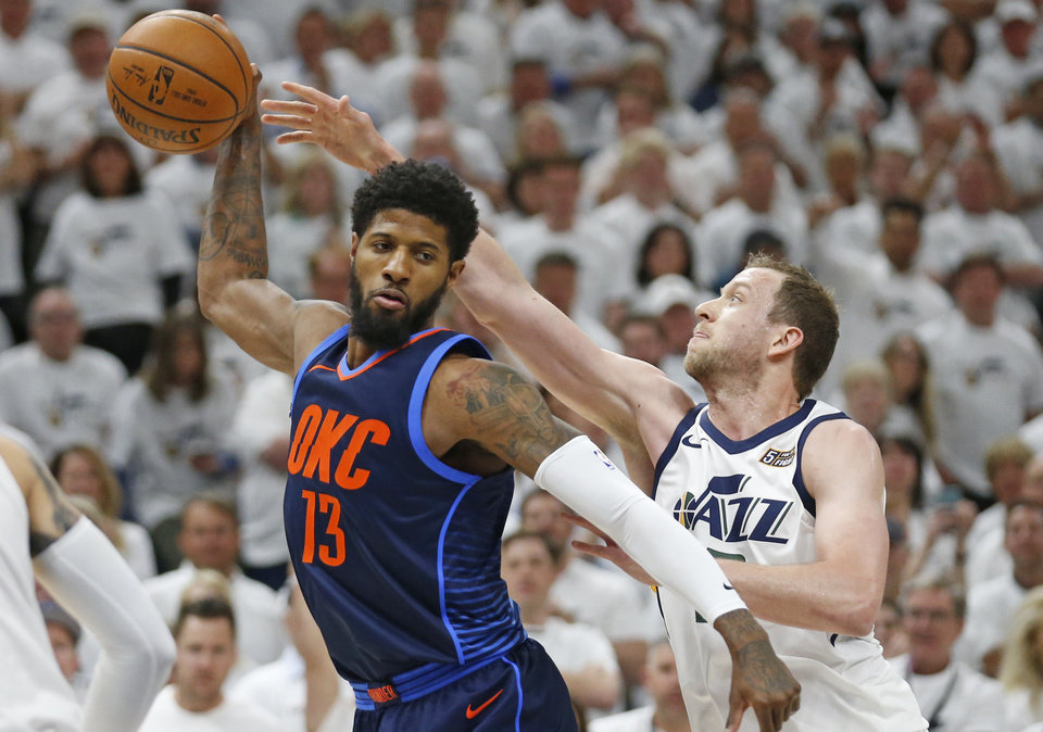 Photo - Utah Jazz forward Joe Ingles, right, guards Oklahoma City Thunder forward Paul George (13) in the first half during Game 4 of an NBA basketball first-round playoff series Monday, April 23, 2018, in Salt Lake City. (AP Photo/Rick Bowmer)