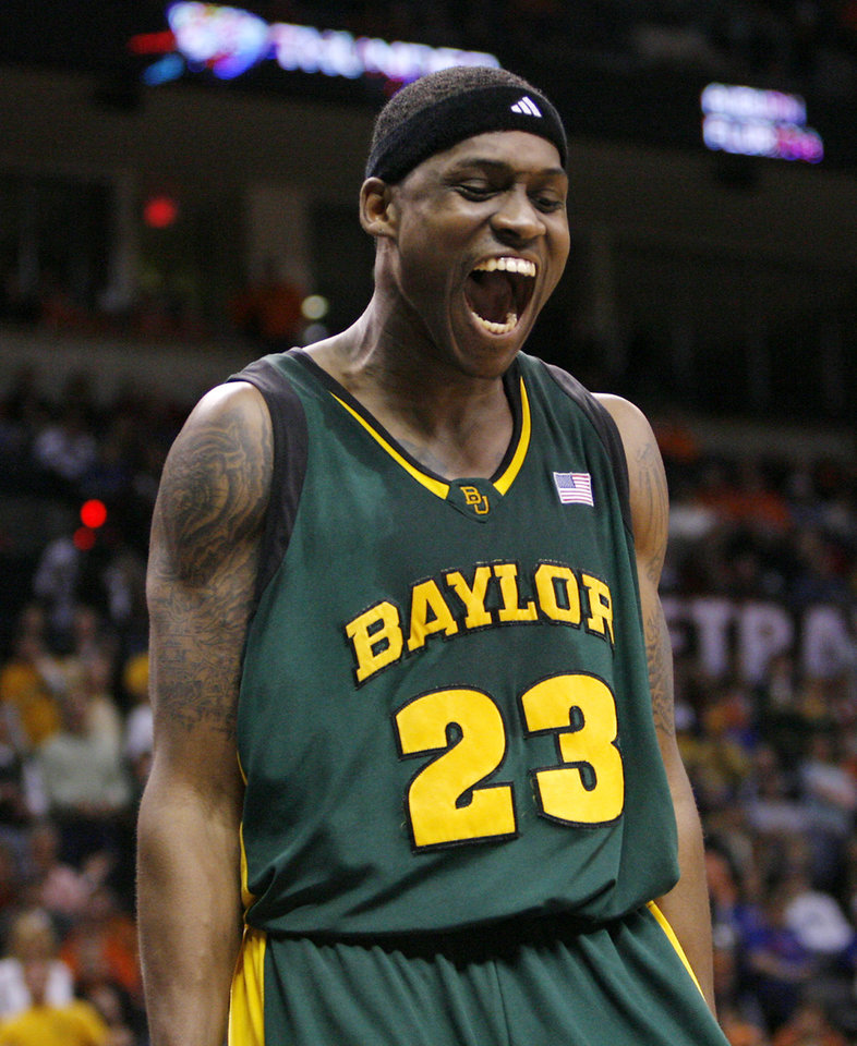 Photo - BIG 12 TOURNAMENT / COLLEGE BASKETBALL / REACTION / CELEBRATE / CELEBRATION: Baylor's Kevin Rogers (23) reacts late in the second half during the Bears upset win over Texas in the semifinal game of the Big 12 Men's Basketball Championships between The University of Baylor and The University of Texas at the Ford Center on Friday, March 13, 2009, in Oklahoma City, Okla.  PHOTO BY CHRIS LANDSBERGER, THE OKLAHOMAN  ORG XMIT: KOD