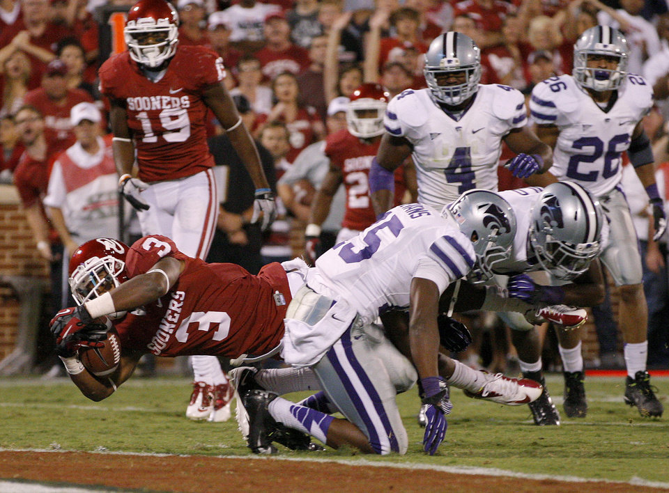 Photo - Oklahoma's Sterling Shepard (3) dives for a touchdown past Kansas State's Randall Evans (15) during a college football game between the University of Oklahoma Sooners (OU) and the Kansas State University Wildcats (KSU) at Gaylord Family-Oklahoma Memorial Stadium, Saturday, September 22, 2012. Oklahoma lost 24-19. Photo by Bryan Terry, The Oklahoman