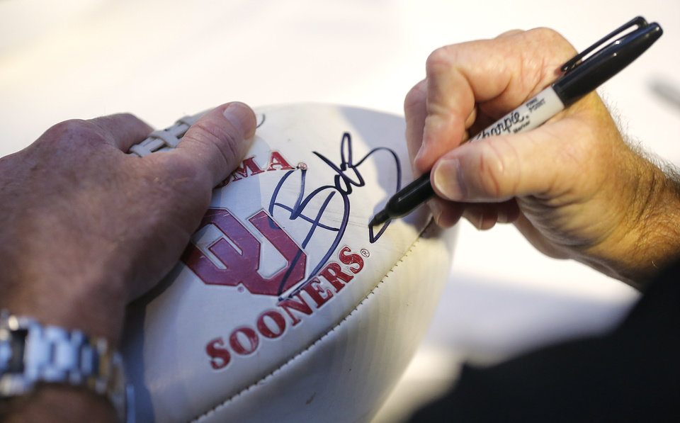 Photo - University of Oklahoma football coach Bob Stoops signs autographs for fans during the Sooner Caravan at the Jim Thorpe Museum in Oklahoma City, Okla. on Wednesday, July 30, 2014.  Photo by Chris Landsberger, The Oklahoman
