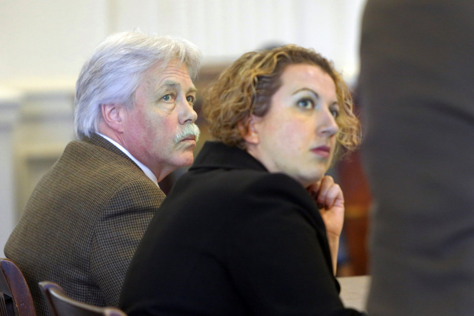 Mark Strong, Sr., left, and co-counsel Tina Nadeau listen to Daniel Lilley address Justice Nancy Mills on Tuesday, Jan. 29, 2013 at York County Superior Court in Alfred, Maine. Mills denied a motion by Lilley to start the trial on the 13 remaining counts against Strong, ordering that the trial be postponed until the Maine Supreme Judicial Court rules on the prosecutors' appeal of the dismissal of 46 charges against Strong. (AP Photo/Portland Press Herald, Gregory Rec)