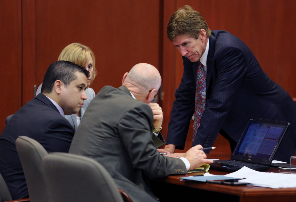 George Zimmerman, left,  confers with his defense counsel, Mark O'Mara, Don West, and Lorna Truett, background, after working out the wording of instructions for a possible charge of manslaughter, on the 25th day of Zimmerman's  trial at the Seminole County Criminal Justice Center, in Sanford, Fla., Saturday, July  13, 2013. Zimmerman has been charged with the 2012 shooting death of Trayvon Martin.(AP Photo/Orlando Sentinel, Joe Burbank, Pool) ORG XMIT: FLJR233