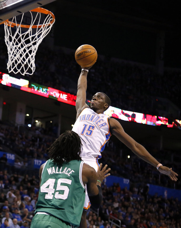Photo - Oklahoma City's Reggie Jackson (15) goes up for a shot over Boston's Gerald Wallace