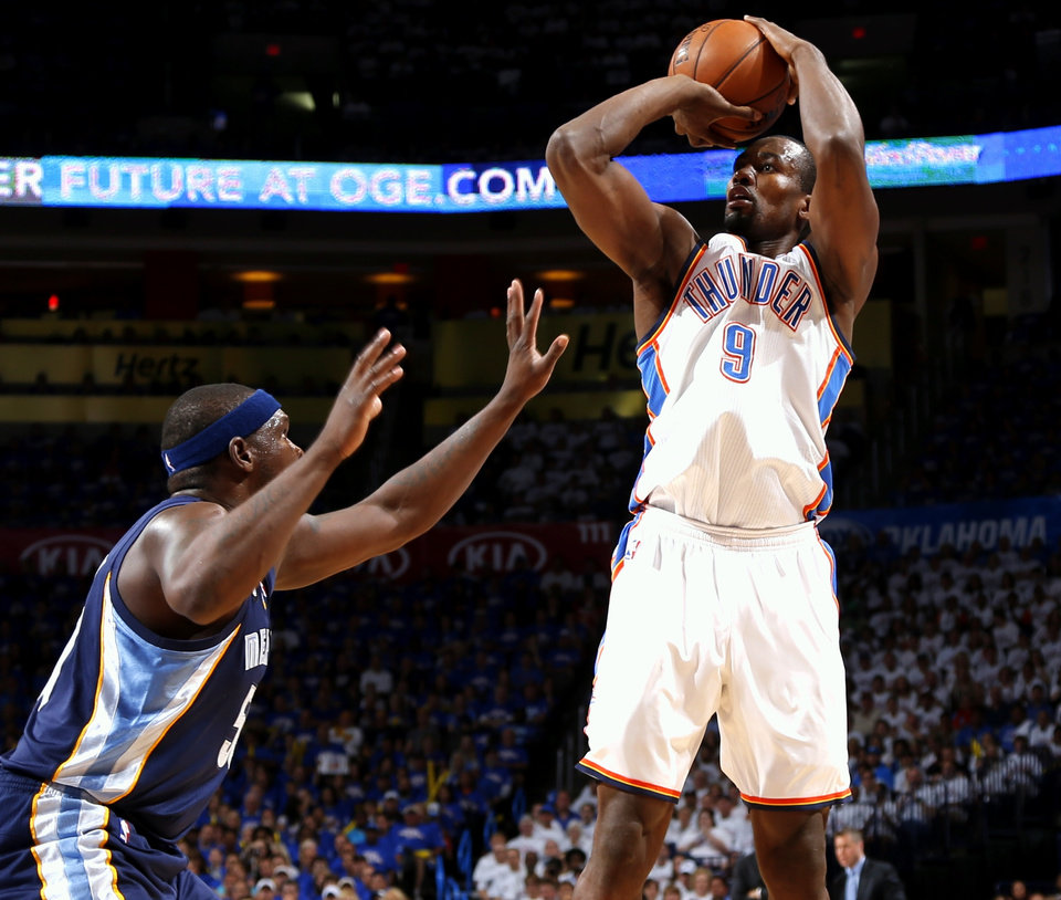 Photo - Oklahoma City's Serge Ibaka shoots the ball over Memphis' Zach Randolph during Game 2 in the second round of the NBA playoffs between the Oklahoma City Thunder and the Memphis Grizzlies at Chesapeake Energy Arena In Oklahoma City, Tuesday, May 7, 2013. Photo by Bryan Terry, The Oklahoman