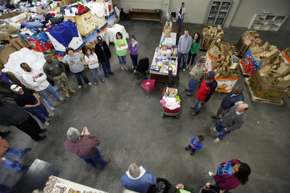 Jesus House Operations Manager Kevin Smith gives instructions to volunteers during the Easter food basket distribution.