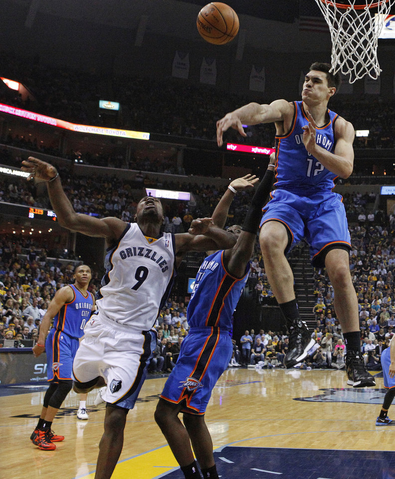Oklahoma City's Steven Adams (12) blocks the shot of Memphis' Tony Allen (9) Reggie Jackson (15) during Game 6 in the first round of the NBA playoffs between the Oklahoma City Thunder and the Memphis Grizzlies at FedExForum in Memphis, Tenn., Thursday, May 1, 2014. Oklahoma City won 104-84. Photo by Bryan Terry, The Oklahoman