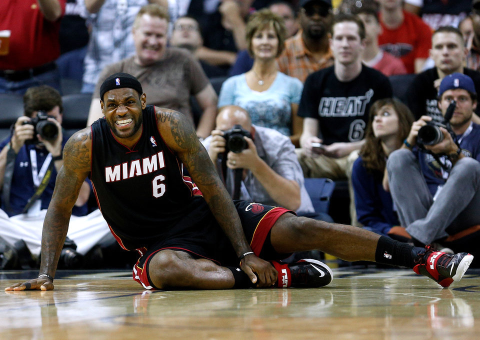 Photo - Miami Heat forward LeBron James reacts after falling to the ground during the second half of an NBA basketball game against the New Orleans Pelicans in New Orleans, Saturday, March 22, 2014. The Pelicans won 105-95. (AP Photo/Jonathan Bachman)