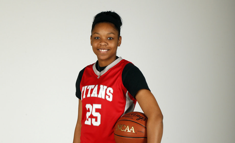 Gioya Carter, Carl Albert High School basketball player and member of the Girls Super 5 and Big All-City team, poses for a photo at the OPUBCO studio in Oklahoma City, Wednesday, April 10, 2013. Photo by Nate Billings, The Oklahoman