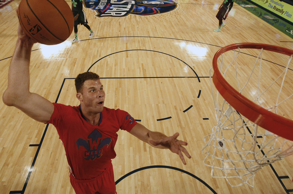 Photo - West Team's Blake Griffin, of the Los Angeles Clippers (32) heads to the hoop as East Team's LeBron James, of the Miami Heat (6) looks on during the NBA All Star basketball game, Sunday, Feb. 16, 2014, in New Orleans. (AP Photo/Gerald Herbert)
