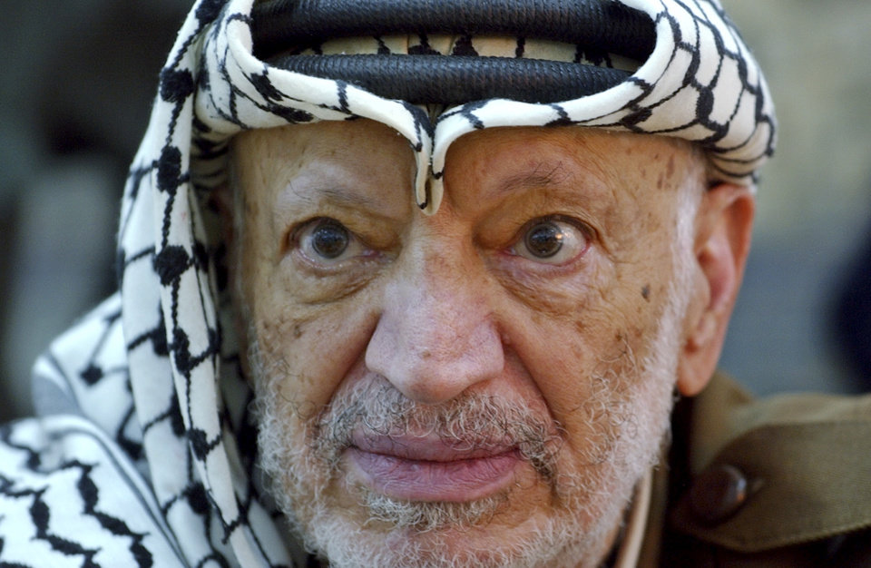 Photo -   FILE - In this Saturday, Oct. 2, 2004 file photo, Palestinian leader Yasser Arafat pauses during an emergency cabinet session, at his compound, in the West Bank town of Ramallah. Palestinian official says the remains of former Palestinian leader Yasser Arafat will be exhumed on Tuesday, Nov. 27, 2012 to enable foreign experts to take samples as part of a probe into his death. (AP Photo/Muhammed Muheisen, File)