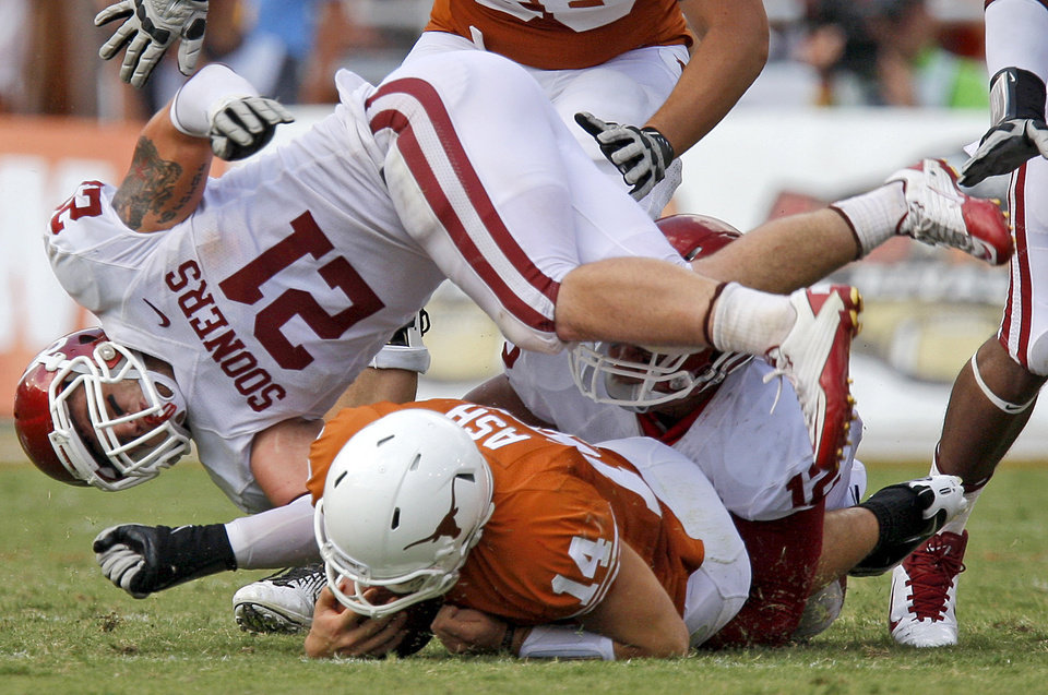 Oklahoma's Tom Wort (21) and Oklahoma's Travis Lewis hit Texas' David Ash (14) during the Red River Rivalry college football game between the University of Oklahoma Sooners (OU) and the University of Texas Longhorns (UT) at the Cotton Bowl in Dallas, Saturday, Oct. 8, 2011.  Oklahoma won 55-17. Photo by Bryan Terry, The Oklahoman