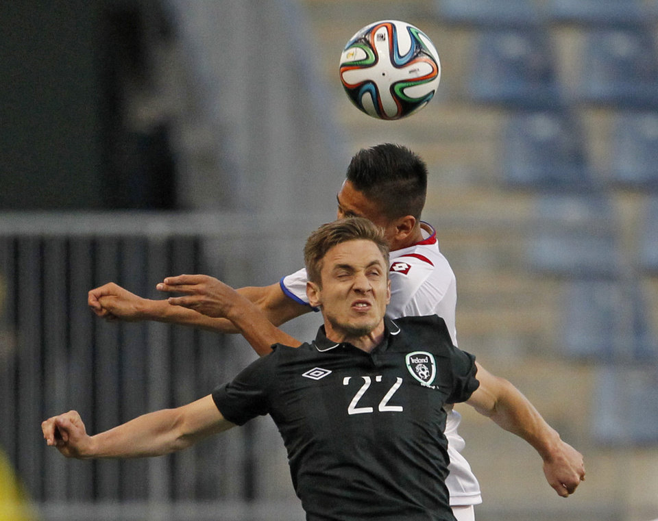 Photo - Ireland's Kevin Doyle, front, battles Costa Rica's Oscar Duarte on Friday, May 6, 2014, in Chester, Pa. (AP Photo/The Philadelphia Inquirer, Ron Cortes)