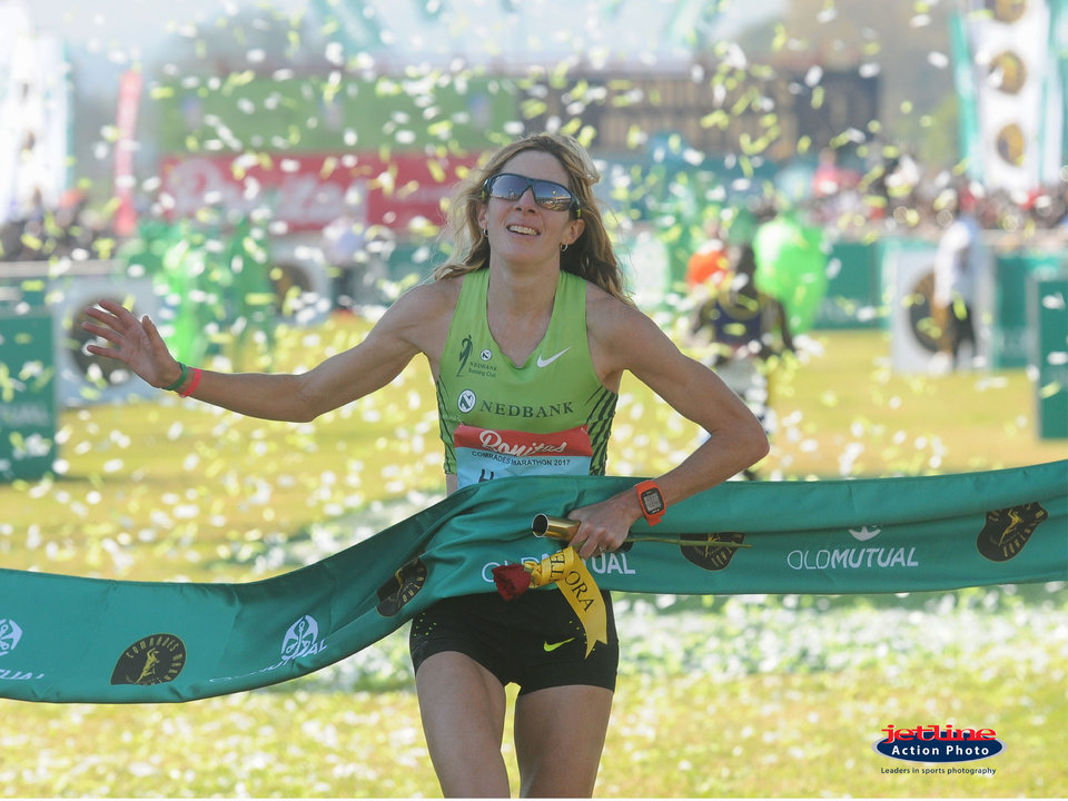 Photo -  Oklahoma native Camille Herron competes in the Comrades Marathon last June in South Africa. [PHOTO BY JETLINE ACTION]