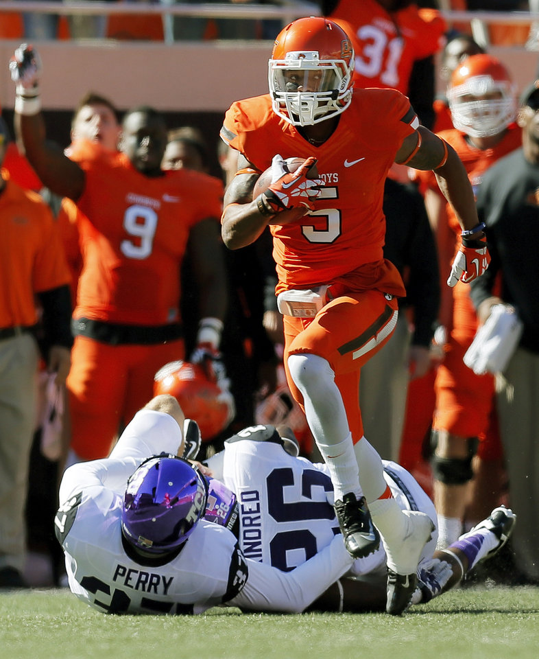 Oklahoma State's Josh Stewart (5) returns a punt 95 yards for a touchdown in the first quarter during a college football game between the Oklahoma State University Cowboys (OSU) and the Texas Christian University Horned Frogs (TCU) at Boone Pickens Stadium in Stillwater, Okla., Saturday, Oct. 19, 2013. Photo by Nate Billings, The Oklahoman