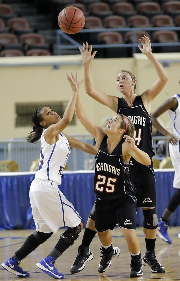 Millwood\'s Teanna Reid (10) battles for the ball with Verdigris\' Baileigh O\'Dell (25) and Courtney Risenhoover (14) during the 3A girls quarterfinals game between Millwood High School and Verdigris High School at the State Fair Arena on Thursday, March 7, 2013, in Oklahoma City, Okla. Photo by Chris Landsberger, The Oklahoman