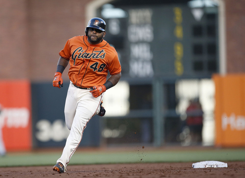Photo - San Francisco Giants' Pablo Sandoval (48) rounds the bases after hits a three-un home run off Minnesota Twins starting pitcher Kyle Gibson in the first inning of a baseball game Friday, May 23, 2014, in San Francisco. (AP Photo/Tony Avelar)