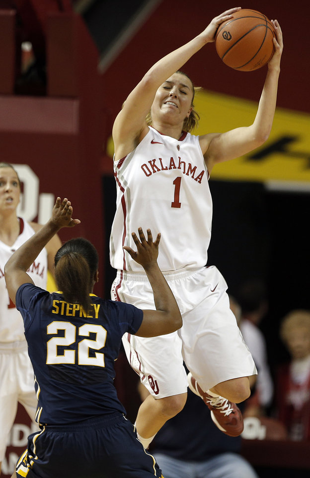 Photo - Oklahoma guard Nicole Kornet (1) grabs a rebound from West Virginia guard Linda Stepney (22) during the women's basketball game between, University of Oklahoma and West Virginia, Thursday, Feb. 13, 2014, in Norman, Okla. Photo by Sarah Phipps, The Oklahoman