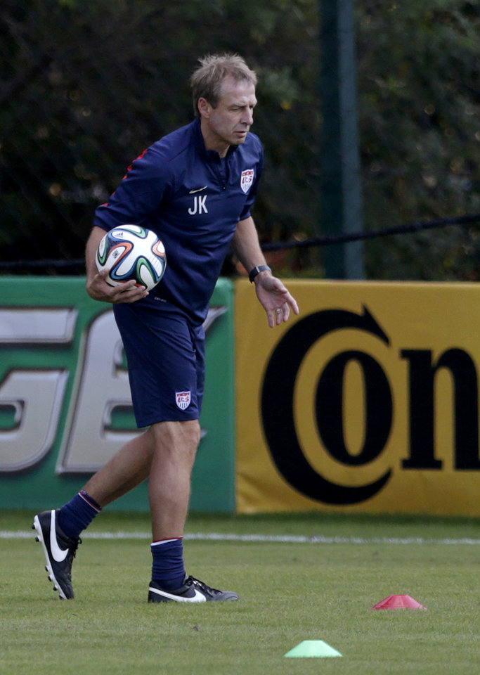 Photo - United States' head coach Jurgen Klinsmann holds a soccer ball during a training session in Sao Paulo, Brazil, Monday, June 23, 2014. The United States will play Germany in group G of the 2014 soccer World Cup on June 26 in Recife, Brazil. (AP Photo/Julio Cortez)