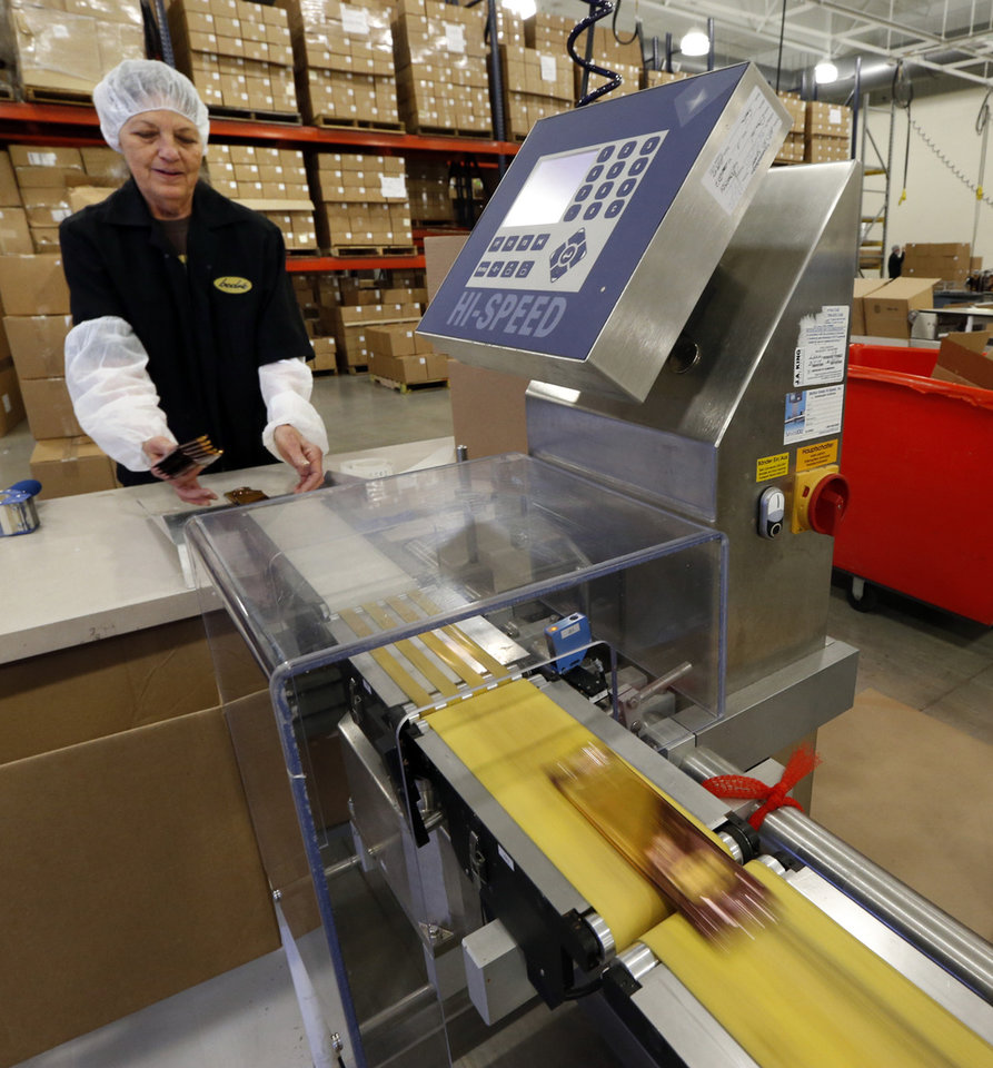 Photo - Charlotte Mason packages chocolate bars at Bedre Fine Chocolate on Friday, Feb. 6, 2015 in Davis, Okla.  Photo by Steve Sisney, The Oklahoman