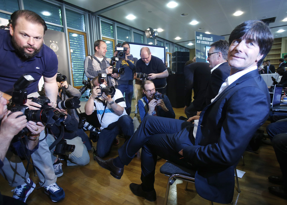 Photo - Coach of German national soccer team Joachim Loew waits for the beginning of a press conference where he presented his preliminary team for the upcoming World Cup in Brazil in Frankfurt, Germany, Thursday, May 8, 2014. (AP Photo/Michael Probst)
