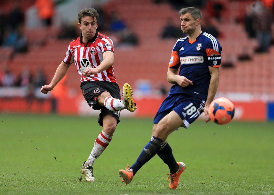 Photo - Sheffield United's Jose Baxter, left, and Fulham's Aaron Hughes in action during their FA Cup, Fourth Round soccer match at Bramall Lane, Sheffield, England, Sunday Jan. 26, 2014. (AP Photo/PA, Nick Potts) UNITED KINGDOM OUT  NO SALES  NO ARCHIVE