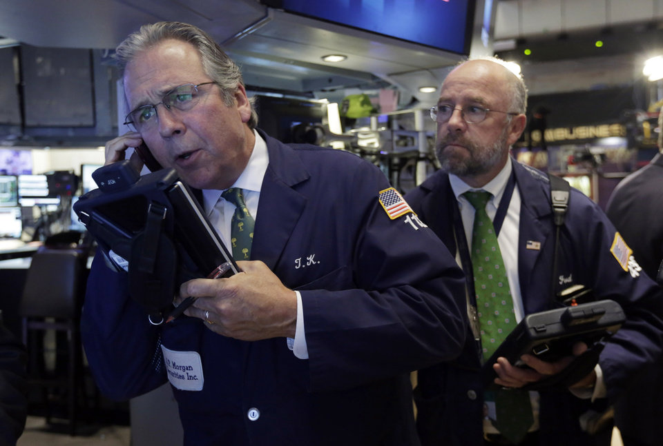 Photo - Traders Thomas Kay, left, and Frederick Reimer work on the floor of the New York Stock Exchange, Thursday, Aug. 7, 2014. U.S. stocks are opening slightly higher after Europe's main two central banks decided to keep interest rates on hold. (AP Photo/Richard Drew)