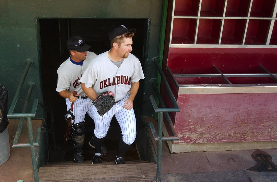 Oklahoma City - June 20, 2003.      MINOR LEAGUE BASEBALL: Pitcher R.A. Dickey heads to the bullpen with catcher Danny Ardoin to workout after reporting to the Oklahoma RedHawks. Dickey was recently sent down from the Texas Rangers baseball team. Staff photo by Nate Billings.