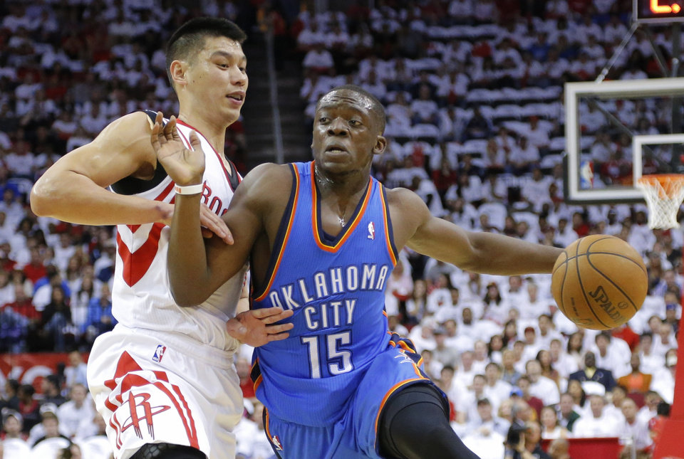 Oklahoma City's Reggie Jackson goes past Houston's Jeremy Lin during Game 3 in the first round of the NBA playoffs between the Oklahoma City Thunder and the Houston Rockets at the Toyota Center in Houston, Texas, Sat., April 27, 2013. Photo by Bryan Terry, The Oklahoman