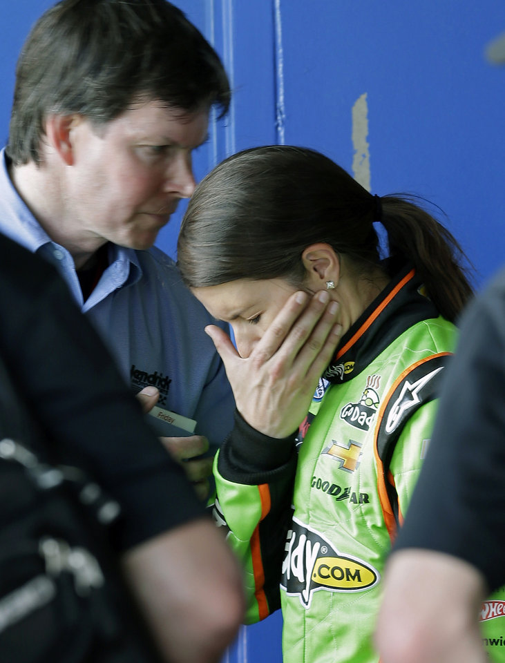 Photo - Danica Patrick, center, talks with members of her team in her garage after she had engine problems in the NASCAR Nationwide Series auto race at Daytona International Speedway, Saturday, Feb. 23, 2013, in Daytona Beach, Fla. (AP Photo/John Raoux)