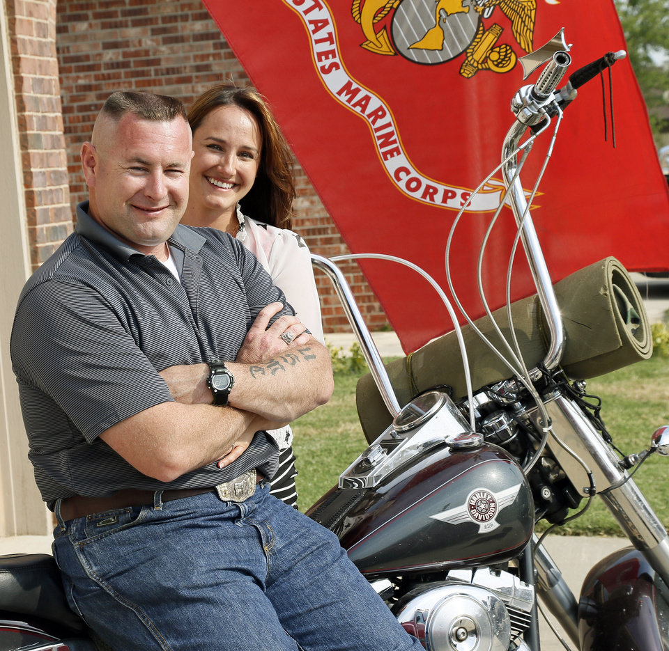 Photo - Brandon Douglas and his wife, Jennifer Douglas, pose for a photo in front of their home in Oklahoma City, Monday, July 1, 2013. Brandon Douglas left the Marines as a Gunnery Sergeant after battling PTSD. Photo by Nate Billings, The Oklahoman