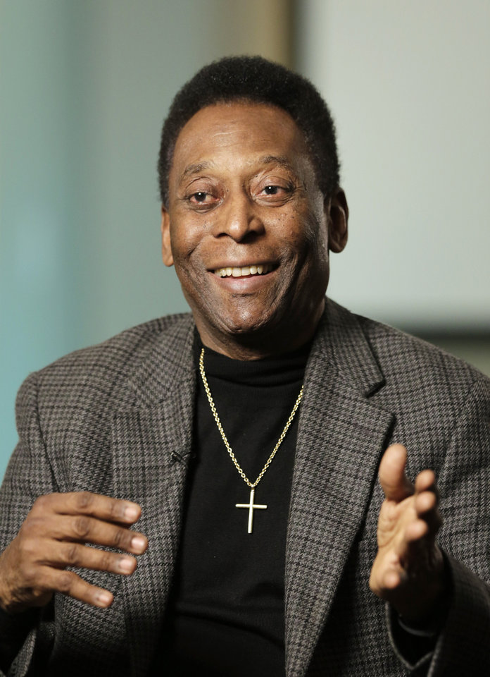 Photo - In this Wednesday, April 2, 2014 photo, Edson Arantes do Nascimento, better known as Pele, is interviewed at The Associated Press in New York. As soccer's showcase returns to the land of