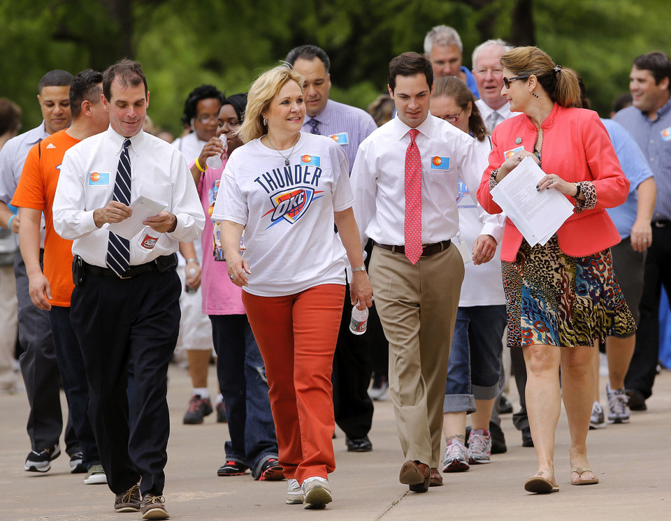 Photo - At left is Dr. Terry Cline, Oklahoma Commissioner of Health. At far right is Jonna Kirschner, executive director for the Oklahoma Department of Commerce.  About 225 state workers, including cabinet members and  agency heads joined Gov. Mary Fallin  on the second wellness walk during the noon hour on  Wednesday, May, 15, 2013. The goal of the event is to promote fitness and exercise among state's residents. The group walked around the north side of the Capitol office complex.  Photo  by Jim Beckel, The Oklahoman.