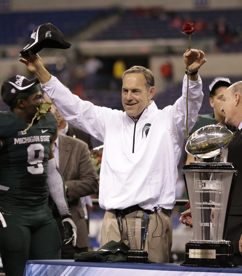 Photo -   MICHIGAN STATE     * Coach:  Mark Dantonio    * 2013 model:  Sooner-like finish — beating Ohio State in Big Ten title game and Stanford in Rose Bowl    * Strengths:  Spartan secondary is stout, even with loss of Thorpe Award winner Darqueze Dennard   * Weaknesses:  Green linebacking corps is a concern    * Key dates: Sept. 6 at Oregon, Oct. 4 at home against Nebraska, Nov. 8 at home against Ohio State    * Outlook:  Spartans should be ranked No. 1 if they win in Eugene         PHOTO BY THE ASSOCIATED PRESS