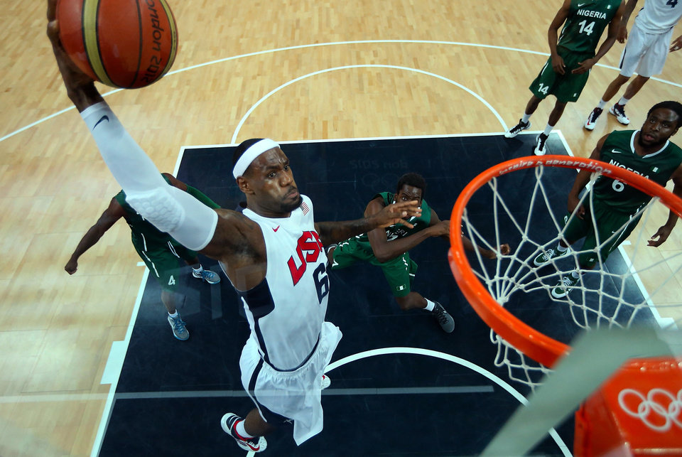 Photo -   Lebron James (6) of the United States shoots against Nigeria during a men's basketball preliminary round match at the 2012 Summer Olympics on Thursday, Aug. 2, 2012, in London. (AP Photo/Christian Petersen, Pool)