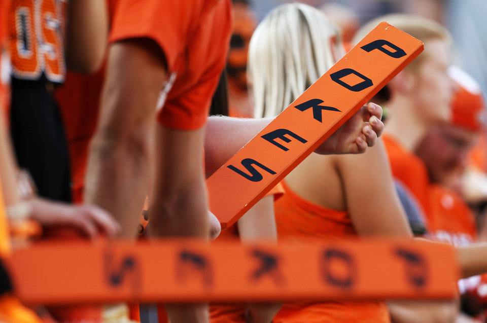 A fan holds an OSU paddle before a college football game between Oklahoma State University (OSU) and Savannah State University at Boone Pickens Stadium in Stillwater, Okla., Saturday, Sept. 1, 2012. Photo by Nate Billings, The Oklahoman <strong>NATE BILLINGS</strong>