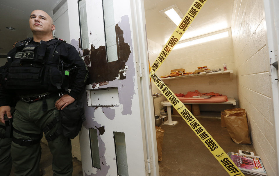 Photo - A Maricopa County Sheriffs Deputy stands watch next the cell of convicted killer Jodi Arias at the Maricopa County Sheriffs Office Estrella Jail, on Thursday, May 16, 2013, in Phoenix. Arias was convicted of first-degree murder in the gruesome killing of her one-time boyfriend, Travis Alexander, in their suburban Phoenix home. (AP Photo/Ross D. Franklin)