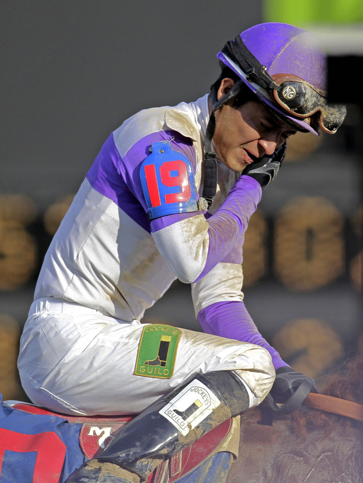 Jockey Mario Gutierrez reacts ridding I'll Have Another to victory in the 138th Kentucky Derby horse race at Churchill Downs Saturday, May 5, 2012, in Louisville, Ky. (AP Photo/Darron Cummings)  ORG XMIT: DBY218