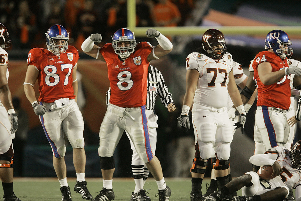 Photo - COLLEGE FOOTBALL: University of Kansas linebacker Joe Mortensen, center, is a returning first-team All-Big 12 pick and on the watch lists for the Lombardi and Nagurski awards.ORG XMIT: 08072619355110000