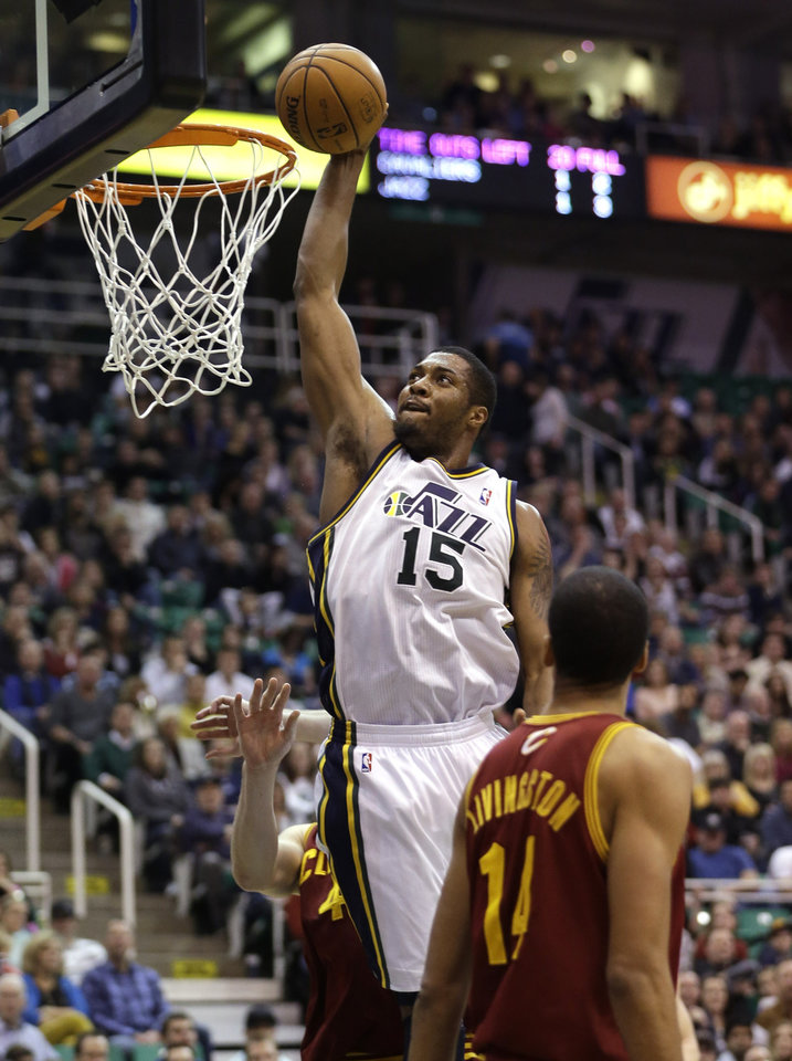 Utah Jazz\'s Derrick Favors (15) dunks the ball as Cleveland Cavaliers\' Shaun Livingston (14) looks on in the fourth quarter during an NBA basketball game Saturday, Jan. 19, 2013, in Salt Lake City. The Jazz defeated the Cavaliers 109-98. (AP Photo/Rick Bowmer)