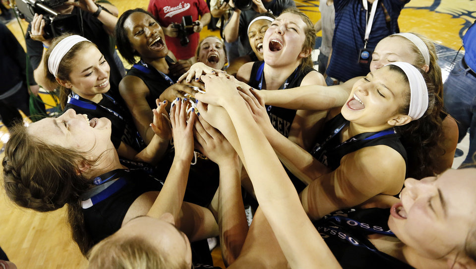 Photo - Deer Creek celebrates with the gold ball trophy after winning  the Class 5A girls championship game in the state high school basketball tournament between against Tulsa East Central at the Mabee Center in Tulsa, Okla., Saturday, March 15, 2014. Deer Creek won, 31-28. Photo by Nate Billings, The Oklahoman